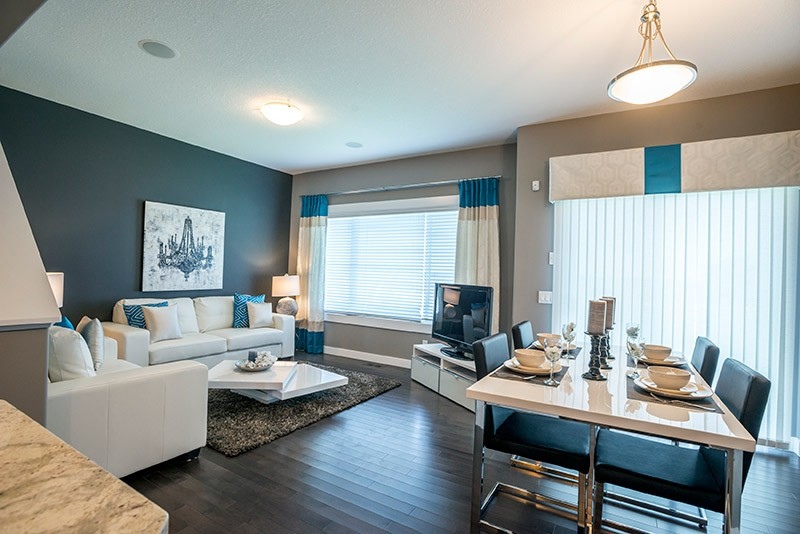 Blue dining and living room by Edmonton home builder City Homes