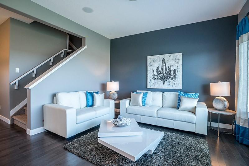 blue living room by Edmonton home builder City Homes