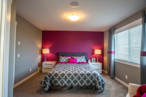 Pink wall bedroom by Edmonton home builder City Homes
