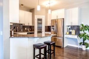 Hardwood kitchen by City Homes, Edmonton new home builder