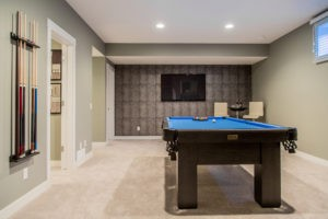 Basement rec room by City Homes Master Builder