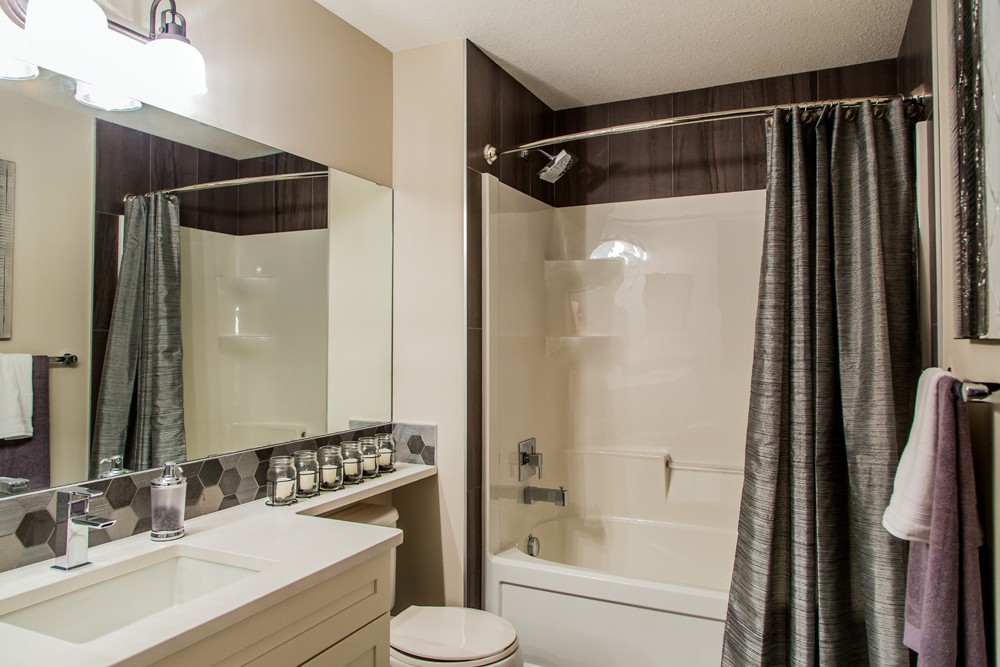 Bathroom in front attached garage Torino model built by City Homes