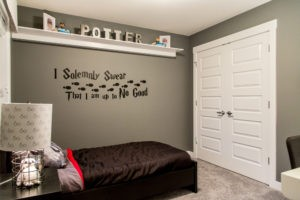 Themed bedroom by Edmonton area new home builder City Homes Master Builder