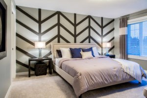 Bedroom with feature wall in Edmonton, new home builder City Homes