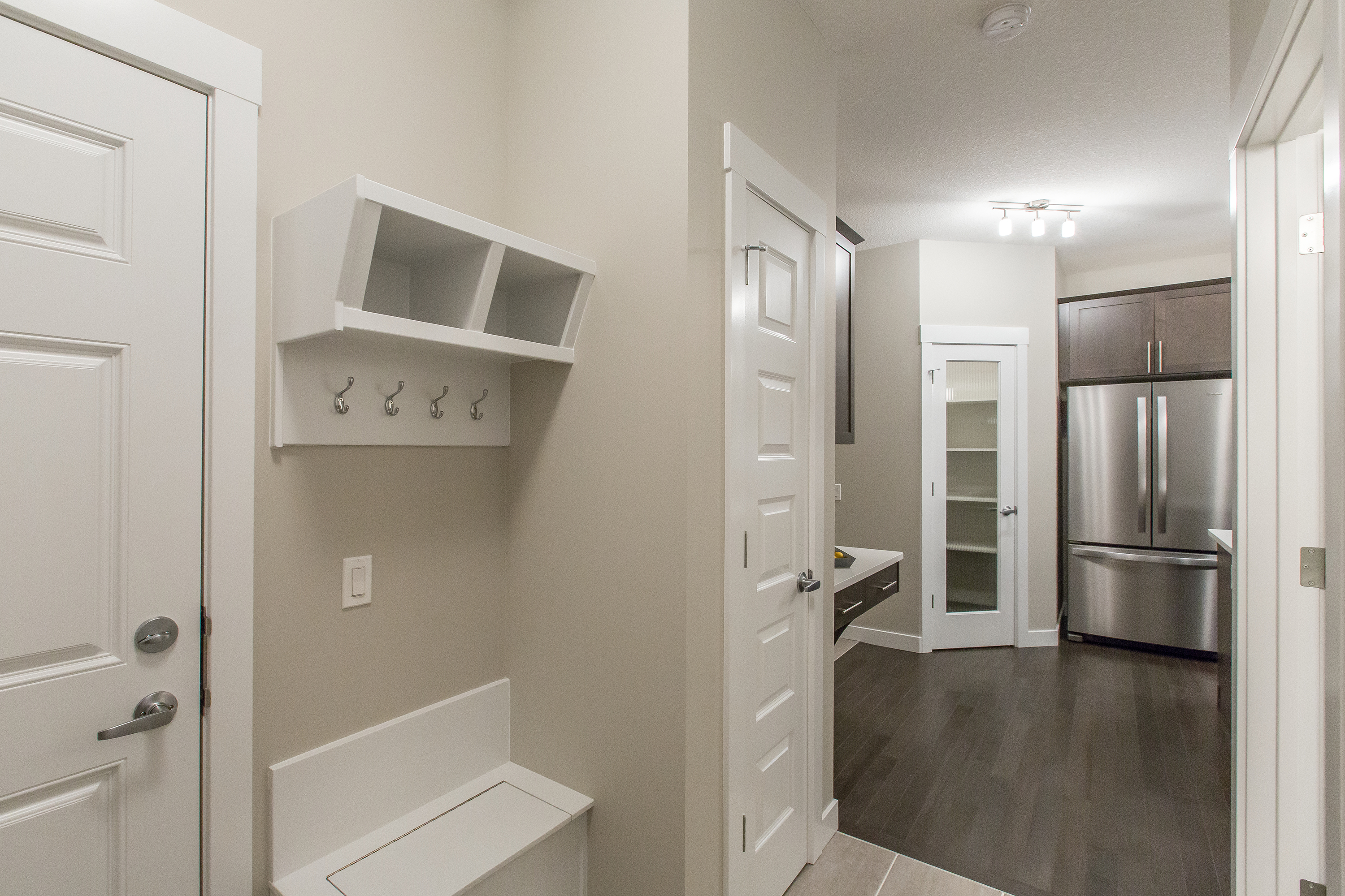 Mudroom and Kitchen of new home built by City Homes Master Builder