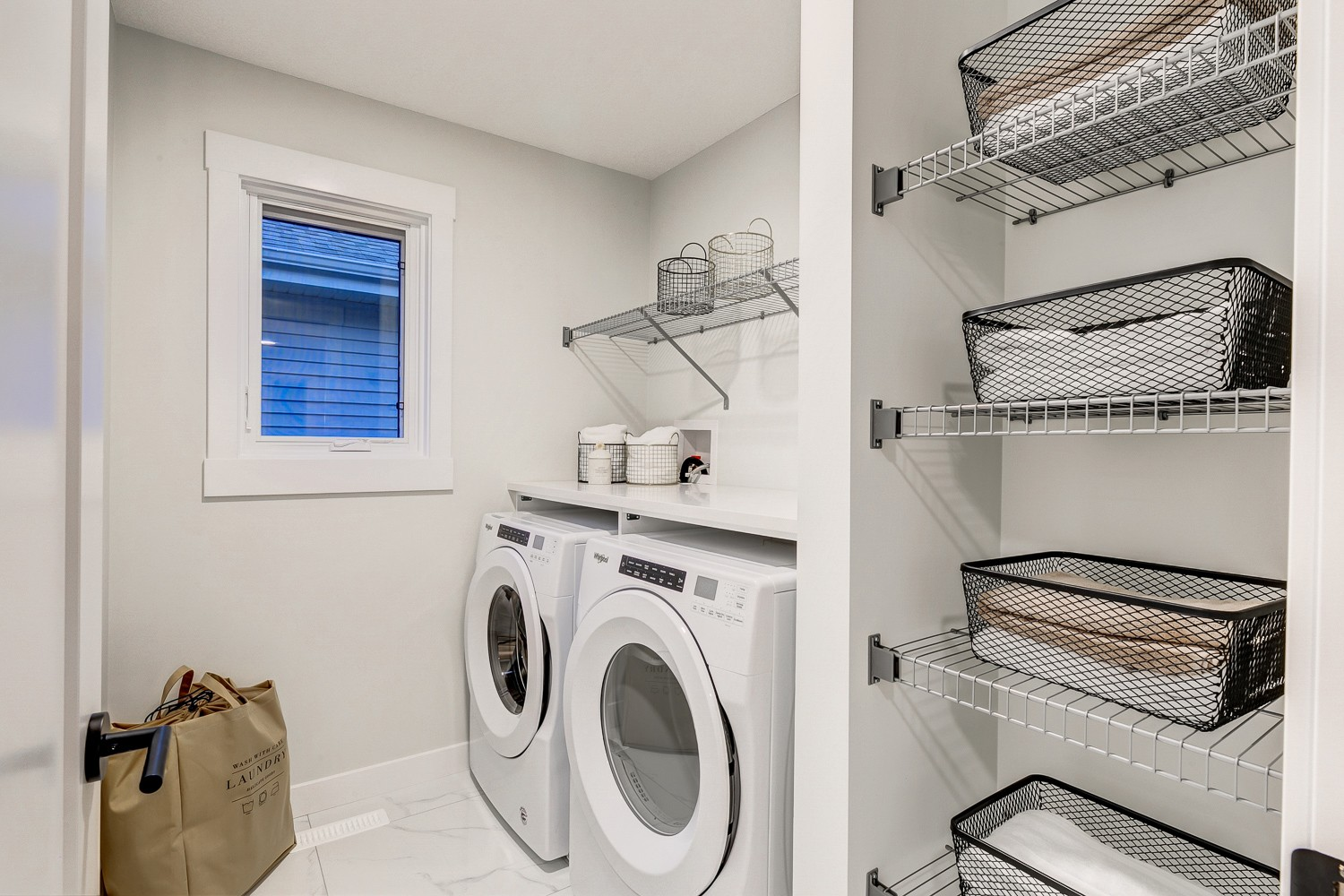 Laundry Room Photo in Single Family by City Homes Master Builder