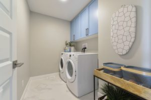 laundry room in detached garage home